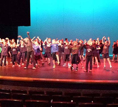 Participate at The Village Theater just like these students on stage